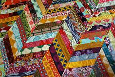 Maureen Cracknell shows you how to take your enormous scrap collection (come on…you know you have a stash!) and turn it into a colorful and fun Herringbone Quilt in her tutorial for Janome!