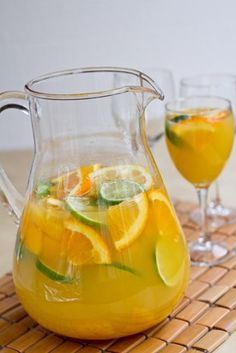 Sunny White Sangria: white wine, orange juice, fruit and club soda Party Drinks, Cocktail Drinks, Alcoholic Drinks, Beverages, Sangria Recipes, Cocktail Recipes, Refreshing Drinks, Summer Drinks, White Wine Sangria