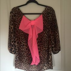 Cheetah blouse with pink bow on back Super cute local boutique find. Size medium. Cheetah print blouse with a super cute pink bow on back. Worn twice. Excellent condition. No trades. Tops Blouses