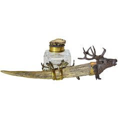 Black Forest Inkwell    19th Century  A magnificent bronze stag head tops a bone pen and inkwell holder with figured brass. Inkwell is heavy cut crystal with a hinged brass lid topped with more natural horn. Whimsical and elegant.