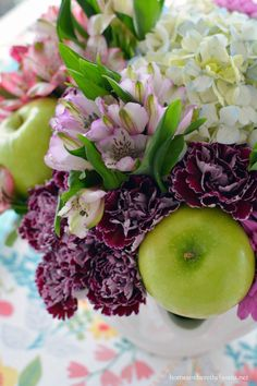 Flower Therapy for the Table and colorblocked floral arrangement with alstroemeria, hydrangea, daisies and carnations, along with some Granny Smith apples | homeiswheretheboatis.net #tablescape #spring