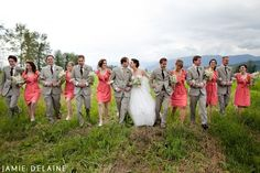 Groomsmen and bridesmaids in coral and grey
