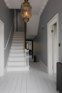 The property is a large double fronted Victorian house, based in Streatham Common, South West London. It has recently been restored and renovated to a beautiful standard, keeping in mind the period in which it was built. It showcases many original period Style At Home, Victorian Hallway, Victorian Fireplace, Edwardian Staircase, Victorian Living Room, Stairway Lighting, Hall Lights Ceiling, Entrance Lighting, Wall Lights