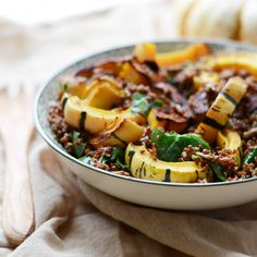 This hearty and satisfying Pesto Delicata Squash Quinoa Bowl is like eating a big 'ol bowl of fall.