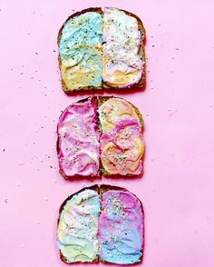 Start with your desired type of toast and brush it with plain white cream cheese as a base. Then add dollops of the colored cream cheeses and start swirling them around on your toast canvas using chopsticks or a butter knife. Then, top it with gold-leaf flakes or pearly pastel sprinkles to make it extra pretty. Or cutting up fruits and veggies in star shapes for added appeal.