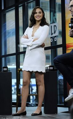Pretty girl: Gal Gadot wore a white mini dress as she hit the AOL Build Series in NYC on T...