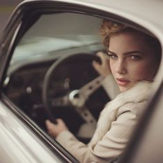 Same model another look. Sophia behind the wheel of a classic car. The extreme