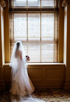Cathedral length veil by Vera Wang tops off a traditional look for bride Eri