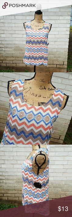 """NWT Lace Back Chevron Tank Knit Blouse Sz Medium New with tags brown ,blue cream knit tank blouse with lace insert panel in back .  Tagged size Medium.  Soft knit stretch fabric, Sheer back piece.  Measurements : Length 22"""" Front 27 """"Back HI Low style  18 """"across front laying flat unstretched  #ravenkittystyle #chevron  #nwt #newwithtags #tank #laceback #medium #spring #springbreak #summer #hilow Tops Blouses"""