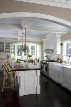 Beautiful white kitchen. Love the island, ceiling, apron front farm sink, backsplash... Smith River Kitchens