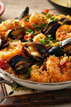 This one-pot mixture of seafood and coarse-grained couscous offers echoes of paella, and a bottle or two of rosé alongside makes for a happy summer dinner.