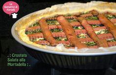 """Panico da """"sono stato invitato da amici per capodanno ad una festa, cosa posso portare al buffet di stasera senza impazzire?""""! Ecco la risposta! :) preparando questa crostata salata alla mortadella avrete il tempo di farvi belli e aggiungerete al buffet dell'ultimo dell'anno una pietanza sfiziosa che andra' a ruba!!!! :) http://blog.giallozafferano.it/ledomatrici/crostata-salata-mortadella/ #crostatasalata #mortadella #mortazza #ricette #ledomatricidifornelli #giallozafferano #bloggz…"""