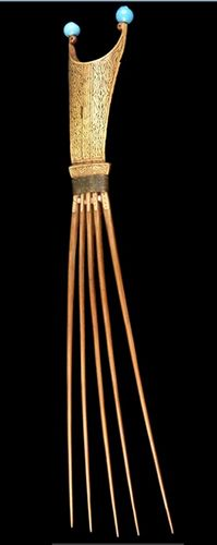 This striking comb with five long teeth, an engraved bamboo top, and two blue beads looks like a dancer. It comes from Seram Island, the largest island of Maluku Province, Indonesia. The comb dates from the late 19th to the early 20th Centuries and was donated by Jean-Paul and Monique Barbier-Mueller. It was probably made for a man.