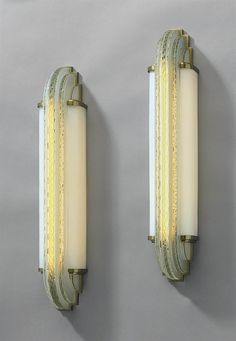 JEAN PERZEL (1892-1986) A PAIR OF APPLIQUES, CIRCA 1937 frosted and polished glass, brass each 28¼ in. (71.7 cm.) high, 5¼ in. (13.3 cm.) wide, 5 in. (12.7 cm.) deep (2)