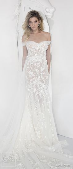 Yaniv Persy Wedding Dresses Spring 2019 - Couture Bridal Collection. Lace boho wedding dress with off the shoulder cap sleeves and sweetheart neckline. Fit and flare bridal gown with cathedral train. #weddingdress #weddingdresses #bridalgown #bridal #bridalgowns #weddinggown #bridetobe #weddings #bride #weddinginspiration #weddingideas #bridalcollection #bridaldress #fashion #dres See more gorgeous bridal gowns by clicking on the photo