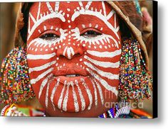 Portrait of an African woman with traditionally painted face
