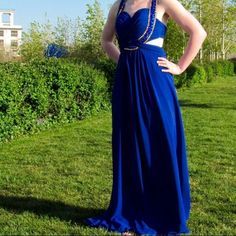 Blue Prom Dress Lovely blue prom dress with gold sequins on the straps. I can't find a tag, but I'd guess size 6.  I'm 5'4 and it was a bit long on me, so if you're taller you should be safe. There's cut outs on the sides and it has a pretty revealing back, I'm going to find some better pictures. Bari Jay Dresses Prom