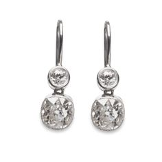 Two-stone diamond earrings on a french wire.