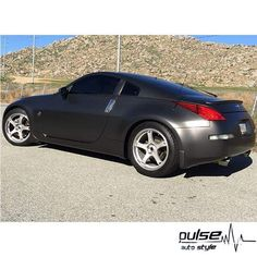 Very nice wrap on the Nissan in Avery Dennison SW900 Satin Pearl Nero. Installed by Pulse Auto Style.