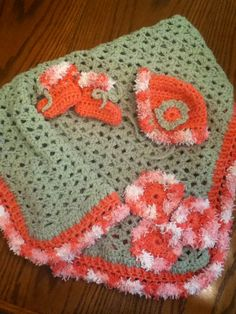 Crochet baby hat,booties, blanket.  I love the color. Mellon green perfect pink. Edging white and different shades of pink.