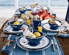 pretty summer table, each guess with their own bottle of wine and lemon (for the seafood)