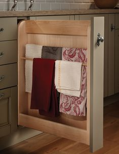 Take that empty filler space and make a convenient place to get your dish towels out of the way