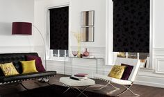 Modern black taffeta patterned roller blinds, white room, contemporary black and white leather sofas