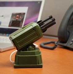 USB Rocket Launcher  This rocket launcher connects to your Windows 2000, XP, Vista machine, Windows 7 or Mac via USB. Install the included software, plug in the Rocket Launcher, and with 360 degree horizontal rotation and 45 degree vertical rotation, the USB Rocket Launcher can fire over six meters, giving you coverage for over 113 square meters of your workspace.