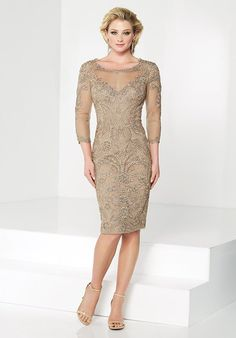 Mother Of The Bride Dress  Chiffon knee-length sheath with illusion lace three-quarter sleeves and bateau neckline, scalloped V-back, sweetheart bodice, center back slit.
