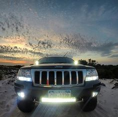 JEEP GRAN CHEROKEE  WITH LED LIGHTS WITH A NICE BACKGROUND SKYLINE