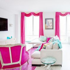 A colorful pink and blue Family Room by Manhattan-based interior designer and boutique owner, Sasha Bikoff, via @sarahsarna.