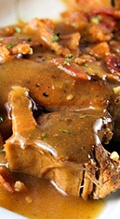 Slow Cooker Smothered Pork Chops with bacon and brown gravy