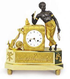 Pendule au matelot, bronze doré et patiné, cadran signé COQUET à Paris, début du XIXe siècle, h. 38 cm.