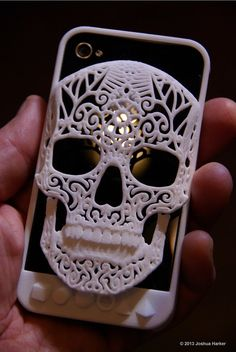 3d printed skull iPhone case. The jaw serves as a clip for your pocket, belt, pack strap, purse, sock, underpants, or karate head band. Theres also room to stuff cash, credit cards, business cards, etc under the skull.