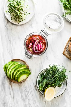 Naturally Sweetened Marinated Red Onions, Sprouts, Dill, Avocado and Gluten-free Buckwheat Bread.