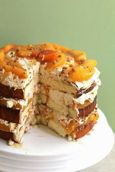 Peach Cobbler Shortcake Cake~T~ Layers of cake topped with Sauteed peaches, Brown Sugar Cinnamon Whipped Cream and a Crumble drizzled with Caramel.