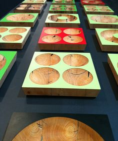 The Ecobol on display at Habitare 2012 from Jouni Leino . The bowls are made from recycled wood that is wedged between two pieces of colorful laminate.