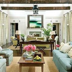 Balance Rustic Elements | Front and back doors open directly into a two-story-high living room, where spruce-planked walls and wood beams salvaged from an 1890 Tennessee barn reflect the home's rural setting and give the space a refined, barnlike feel. | SouthernLiving.com