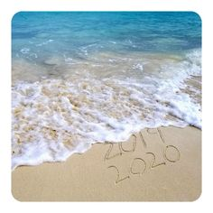 New year 2019 sign in tropical beach sand with turquoise ocean stock photo - 103214283