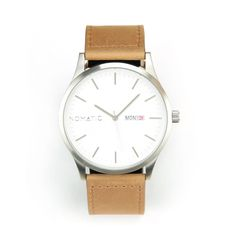 The Silver / White NOMATIC Watch is as classy as it gets, and was built to last. On the outside it has a 45mm silver plated stainless steel casing, and a Swiss Ronda movement on the inside. The NOMATI