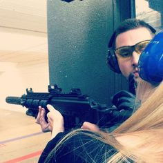Me shooting a rifle in Minneapolis
