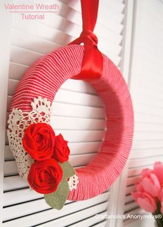 Pretty, Valentine's Day Yarn Wreath with rolled felt roses. Sweet! From Craftaholics Anonymous. Like the doily idea
