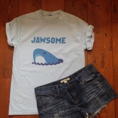 "Hipster shark t-shirt. Light blue grunge tee. Jaws Super cool light blue ""jawsome"" T-shirt. Unisex medium. Pre-loved-small bleach mark on collar-see last photo.  Perfect for your grunge wardrobe! Gildan Tops Tees - Short Sleeve"