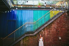 Vibrant, Modern Bridal Shoot… House of Ollichon bridal jumpsuits, colour wedding decor, flamingos, industrial Bristol wedding venue. Photos by Through The Woods We Ran, featured on Mr & Mrs Unique www.mrandmrsunique.co.uk