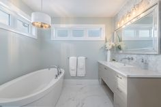 What makes a great Master Ensuite? We think dreamy lighting and a stand alone bath tub are a great start! Custom Home Builders, Custom Homes, New Home Construction, Bath Tub, Home Renovation, Master Bathroom, New Homes, Floor Plans, Flooring
