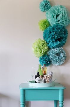 DIY Tissue Pom Pom Backdrop. These are all the colors I need!!!