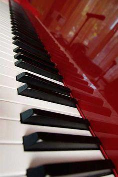 Dark red piano, white and black piano keys http://pinterest.com/cameronpiano