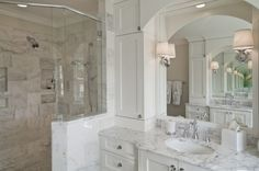 Love this bathroom, vanity, Restoration Hardware sconces, Cisal by Rohl faucet, single sink - Carolina Design Associates, LLC