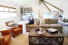 interior design and furnishings by alice lane home collection and caitlin creer | family room, cognac leather chairs, gray sectional
