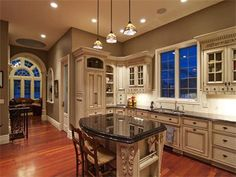big beautiful kitchen! Love the windows and the lighting.